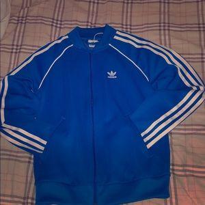 adidas Originals three stripe track suit in blue